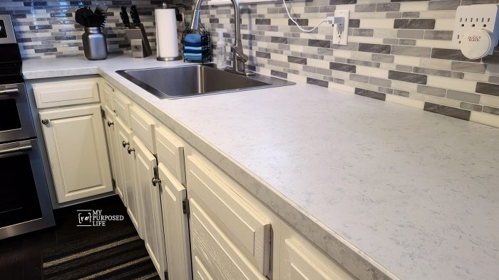 peel and stick backsplash and painted countertops