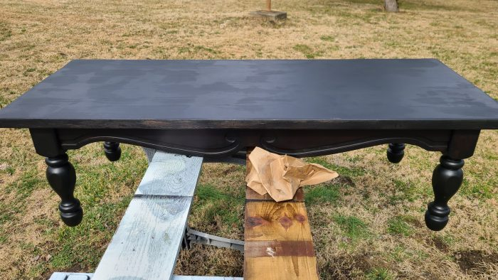 black coffee table after first coat of paint