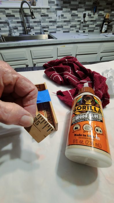glue yardstick biz card holder with wood glue