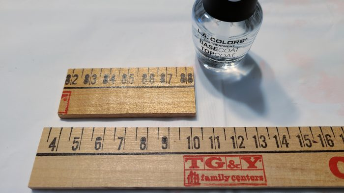 use clear nail polish to seal yardstick project