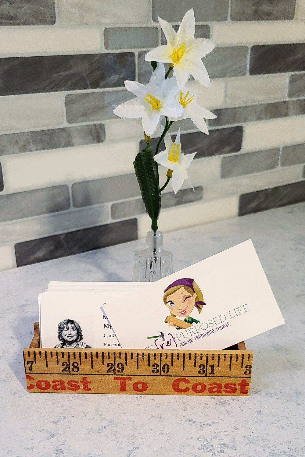 Easy directions and tips on how to make a yardstick business card holder. With a few adjustments, you could make a larger tray or similar item. #MyRepurposedLife #repurposed #yardstick #bizcardholder via @repurposedlife