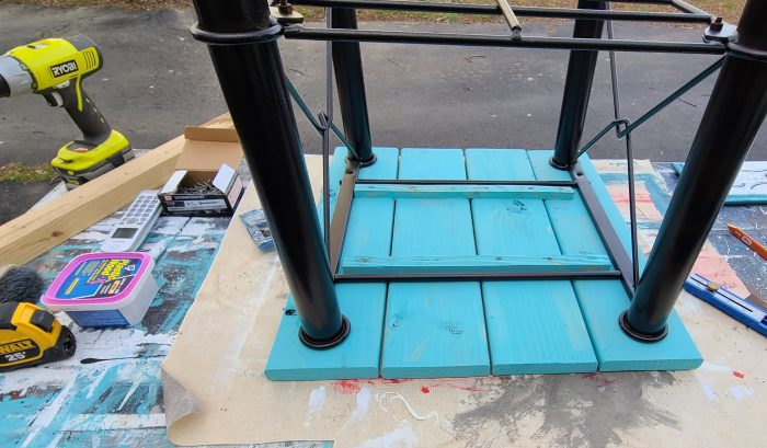attach new table top to upcycled metal table frame