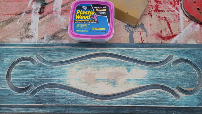 blue drawer front with patched holes