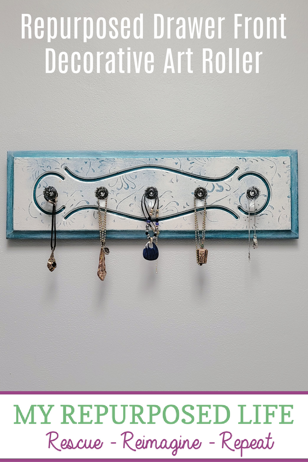How to make a wooden hanging necklace organizer using a repurposed drawer front and new glass knobs. Hang jewelry, scarves, hats and more. #MyRepurposedLife #repurposed #drawer #jewelry #organizer #diy via @repurposedlife