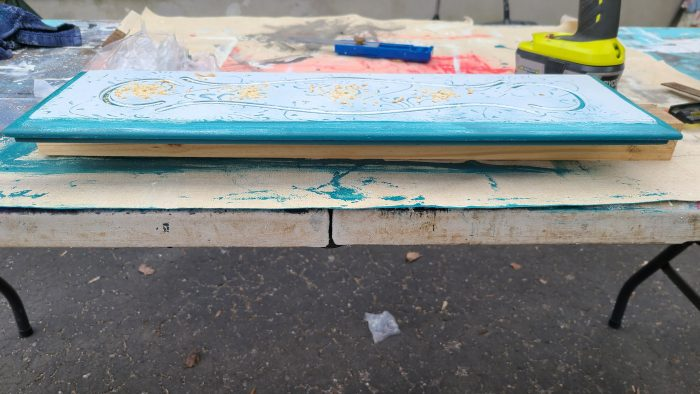 scrap wood helps prevent splintering when drilling pilot holes