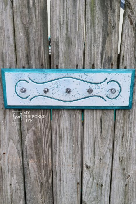 hanging necklace organizer made from a repurposed drawer front