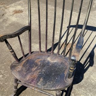 wooden rocking chair in bad shape